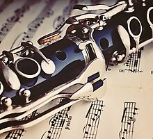 Clarinet on a sheet music by Pixmover