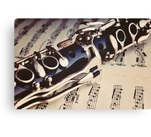 Clarinet on a sheet music Canvas Print