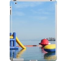 beach toys and equipment floating on sea iPad Case/Skin