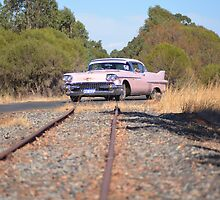 Pink Caddy On Rails by Neil Bushby