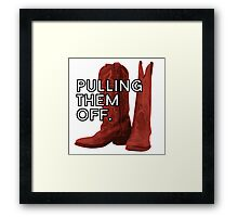 Pulling. Them. Off. The Red Boots. Framed Print