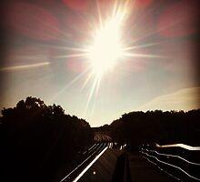 Sun on tracks  by Ritkey