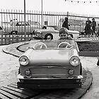 Boy on fairground car by beanphoto