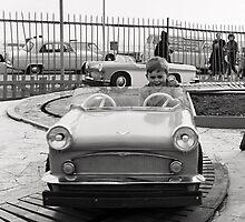 Boy on fairground car by beanphoto