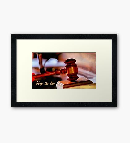Obey the law Framed Print