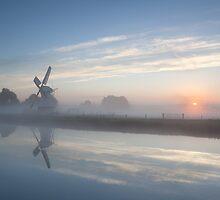 Sunrise and windmill by Olha Rohulya