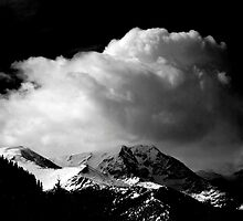 Clouds in the Rocky Mountains  by Roger Passman