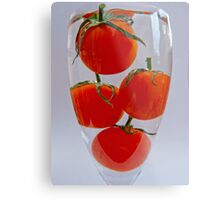Tomatoes in a glass of water Metal Print