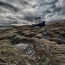 boat on the shore by christopher lonie