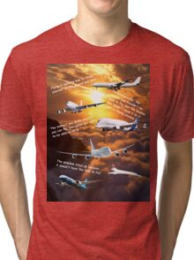 Planes in a cloudy sunset sky Tri-blend T-Shirt