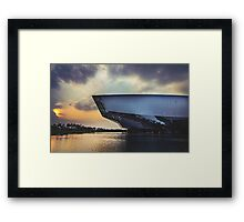 Sun Setting Over a Modern Building Framed Print