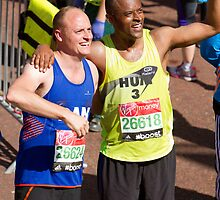 Humprey Nemar and Dan Charity with their London Marathon medals by Keith Larby
