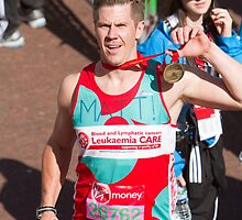 Matt Bell with his london Marathon medal by Keith Larby