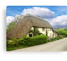 A Quaint Little Thatched Cottage Canvas Print
