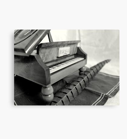 Piano and quill Canvas Print