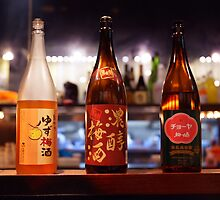 Japanese sake bottles in a bar art photo print by ArtNudePhotos