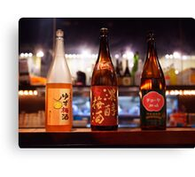 Japanese sake bottles in a bar art photo print Canvas Print