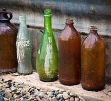 Bottles on the ground by Carol Fan
