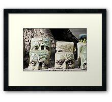 Sunken Heads Framed Print