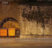 Manchester Tunnel with Orange Bins by Gavin  Cleary