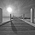 Pier in black and white by Cole Stockman