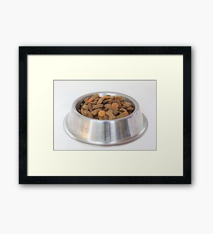 Bowl with dry dog food Framed Print