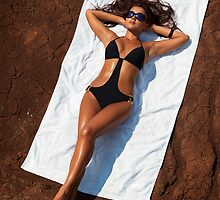 Young sexy woman in swimsuit sunbathing art photo print by ArtNudePhotos