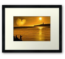 silhouette of father and son loving fishing in Ireland Framed Print