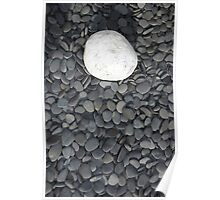 lone white stone amongst many grey pebbles Poster