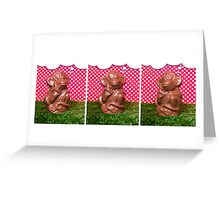Chocolate monkey on the grass Greeting Card