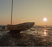 Boat at low tide at sunset by margaret986