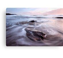 Steadfast rocks in the backwash  Canvas Print
