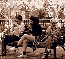 Ladies at lunch time in the Treasury Gardens Melboune by Ronald Rockman