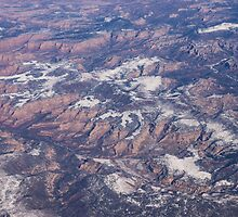 Red Earth Canyons with a Dusting of Snow by Georgia Mizuleva