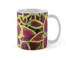 Red and green tropical plant Mug