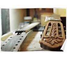 Guitar grips repairing shallow dof Poster