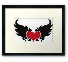 A flaming heart Framed Print
