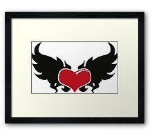 A flaming heart Framed Print