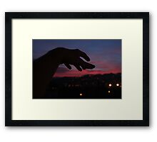 Hand reaching to sunset, landscape photography Framed Print