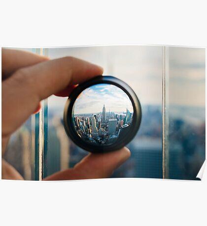 Man holding a lens over Manhattan Poster
