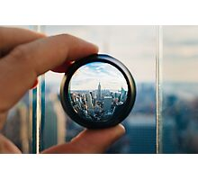 Man holding a lens over Manhattan Photographic Print