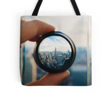 Man holding a lens over Manhattan Tote Bag