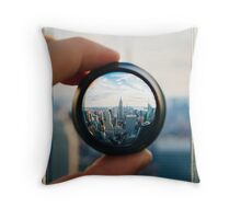 Man holding a lens over Manhattan Throw Pillow