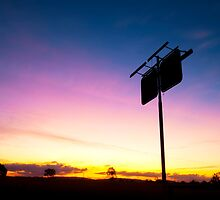 Old rustic fuel station sign as a silhouette. by Rob D