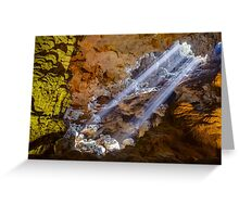 Sun rays shine through ceiling hole in Dau Go cave in Halong Bay, Vietnam Greeting Card