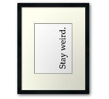 stay weird. Framed Print