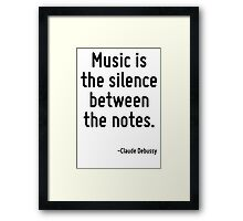 Music is the silence between the notes. Framed Print