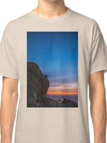 A rock looks like human face Classic T-Shirt