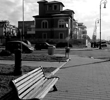 Ostia seafront: buildings, street lamp, cars, bench, fountain by Giuseppe Cocco