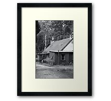 Tin house in the woods Framed Print